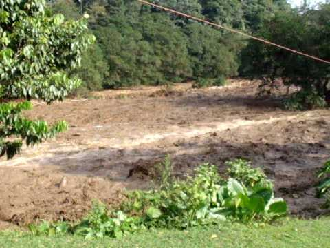 Landslide rushing down the Sarapiqui after earthquake