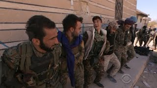 Syrian fighters celebrate in Raqqa after driving out ISIS