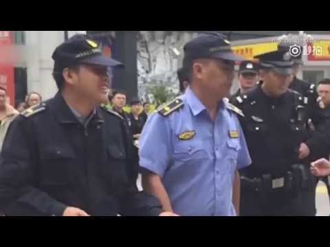 Chinese Police humiliate blind masseur