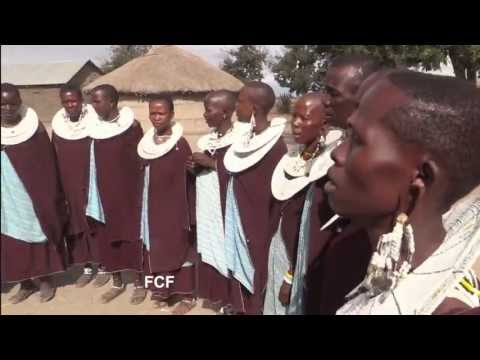 A Tanzanian Maasai tribe's singing and jumping dance in their boma