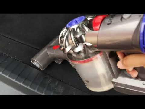 Dyson V8 Vacuuming the car