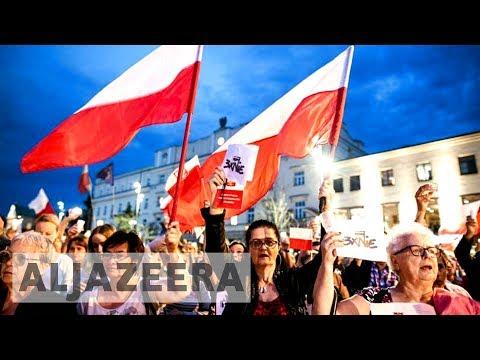 Poland President Andrzej Duda to veto judiciary reform bills
