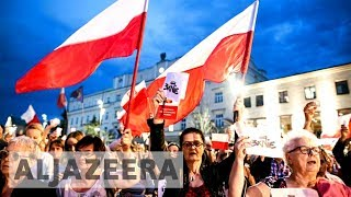 Poland President Andrzej Duda to veto judiciary reform bills