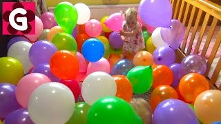 Kids having fun in a ROOM FILLED with BALLOONS