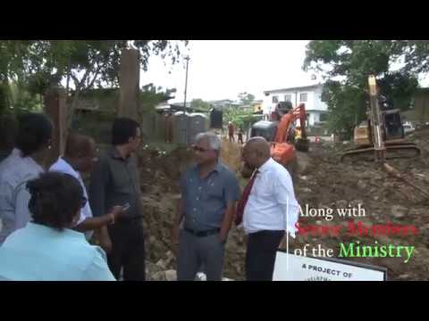 Minister Kazim Hosein pleased with works being performed by RDC on Kent Street, Williamsville.
