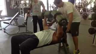 Big Wayne presses 200 lb. Dumbbells for reps.mov