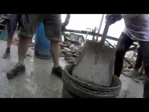 Passing Buckets of Cement: Team Work Helping to Rebuild Manila's Slum (Construction Site Volunteers)