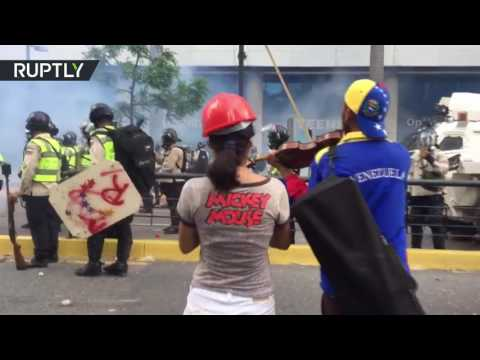 Art vs. Police: Officers teargas protester playing violin in Venezuela