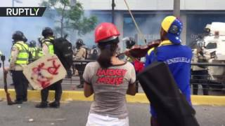 Art vs  Police  Officers teargas protester playing violin in Venezuela