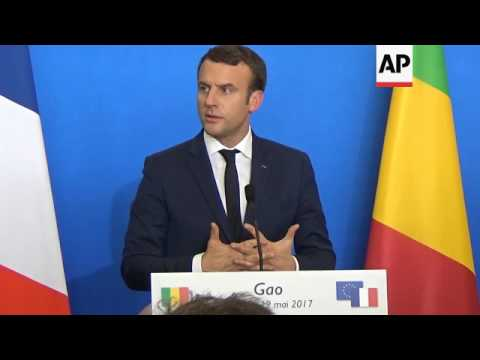Macron inspects troops, meets Mali president