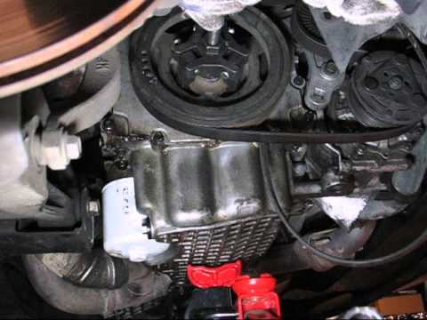 How To Remove Crank Pulley From Chrysler 2 7 Engine Youtube