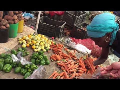 Where can you find cheaper fresh meat and vegetables in Luanda Angola.
