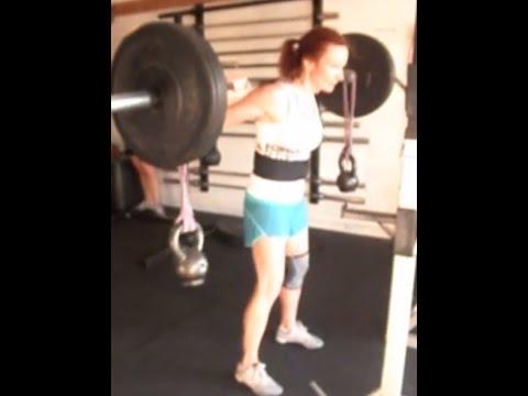 Sally does bamboo bar squats