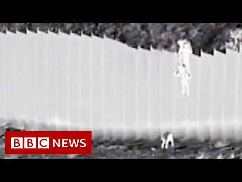 Children dropped over US border wall - BBC News