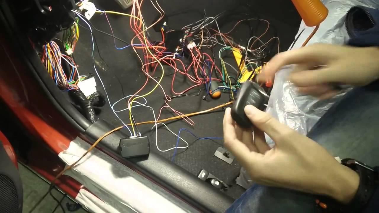 где находится иммобилайзер на киа спектра
