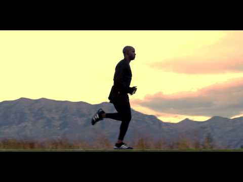 Lifestyle stock footage of Man running against silhouetted mountain