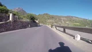 Cycling through Deia, Mallorca, Spain