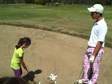 Free Golf Lessons Kids Hitting Snakes Out Of The Sand