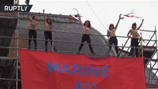 Topless FEMEN activists occupy voting station in Le Pen stronghold