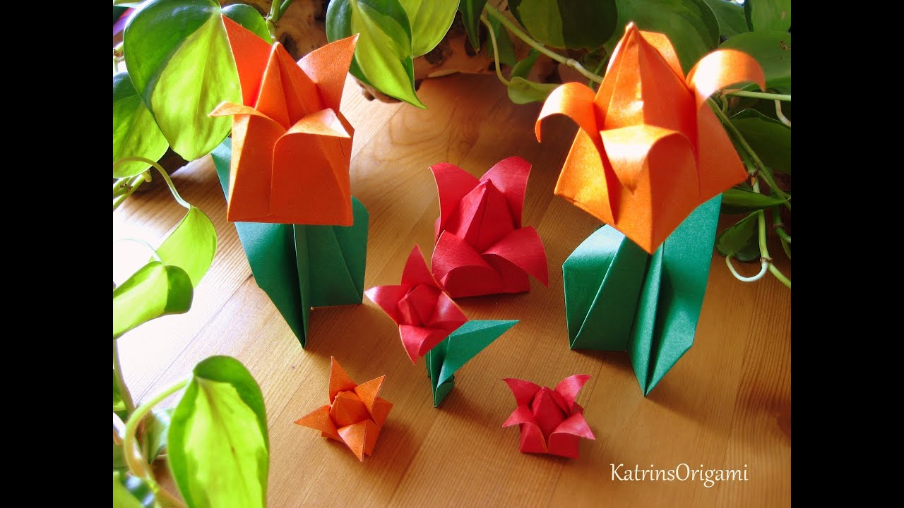 Origami tulip man tutorial. adult man hands making spring flower ... | 720x1280