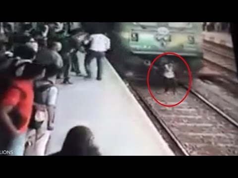 Distracted woman gets run over by train