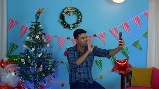 Cheerful Indian happily greeting his friends on Christmas Eve over a video call