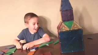 Learn with Lucca how to make a house using magnetic tiles