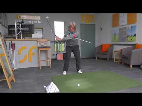 Rotate your body like a pro through impact for correct golf swing release