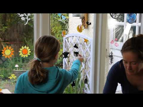 Sticking Thorndown Peelable Glass Paint Window Clings on a window