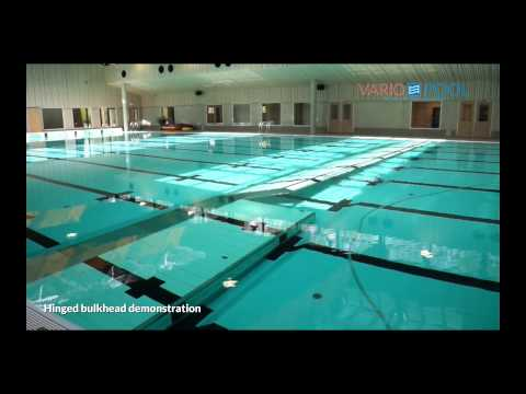Hinged bulkhead swimming pool