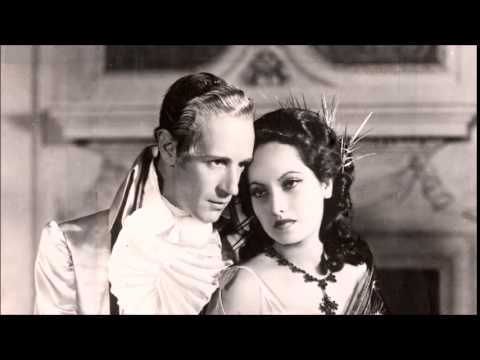 """Leslie Howard and Merle Oberon in """"A Minuet"""""""
