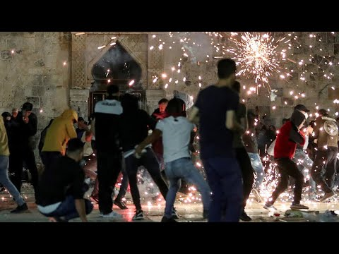 Scores Injured As Israeli Police, Palestinians Clash At Jerusalem's Al-Aqsa Mosque