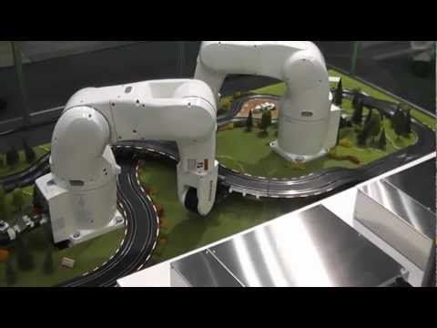 DENSO Robotics - Robots lay out slot-car track