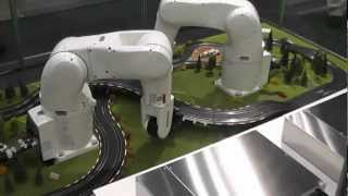 DENSO Robotics - Robots lay out slot-car track(DENSO New VS-Series 6-axis articulated robots lay out a slot-car track, demonstrating the power of DENSO's b-CAP binary controller access protocol., 2012-08-03T21:36:45.000Z)