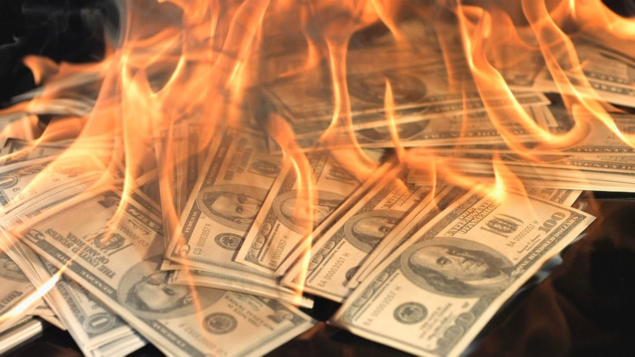Image result for images of burning stacks of money