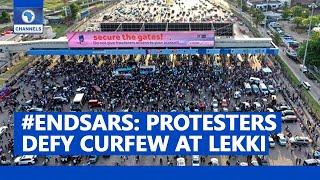 #ENDSARS: Protesters In Lekki Defy Curfew