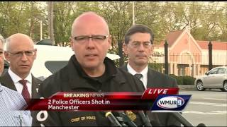 Police: 2 officers shot in Manchester