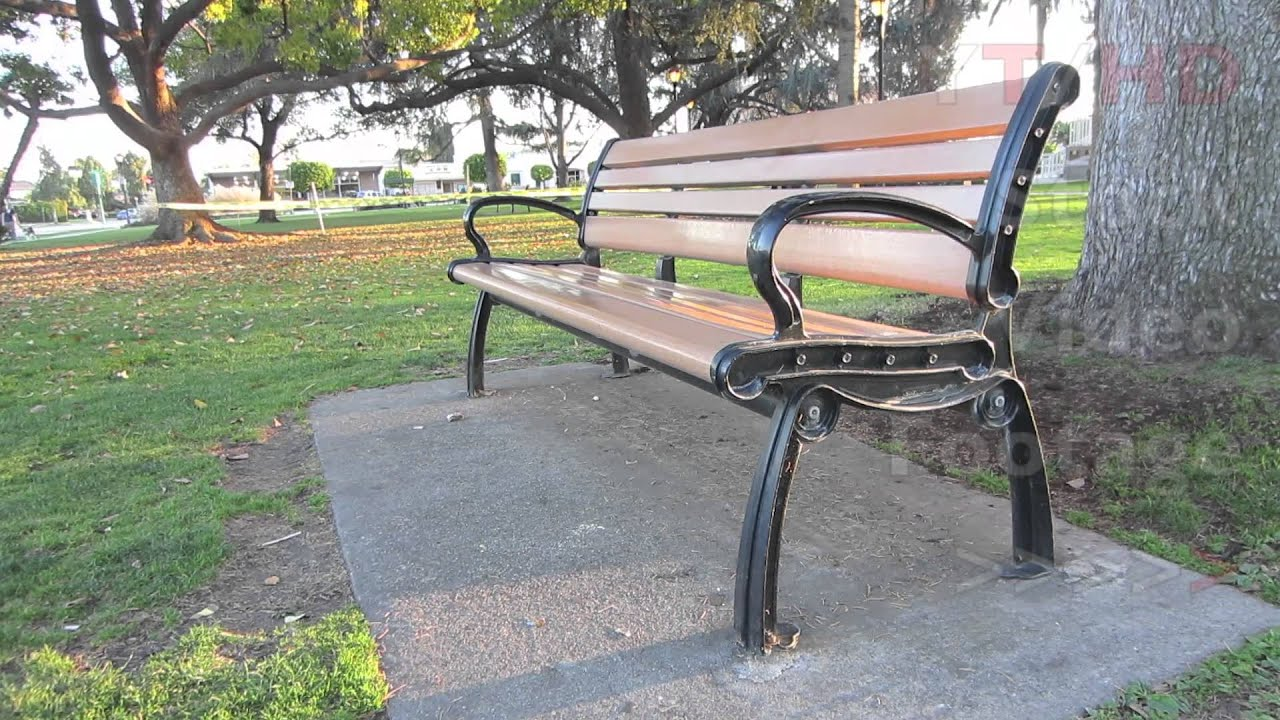 Outdoor public wooden park bench w metal wrought or cast Garden benches metal