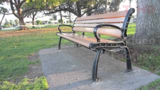 Outdoor Public Wooden Park Bench W/ Metal Wrought Or Cast Iron Ends & Parts | Hd Stock Video Footage