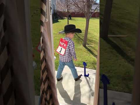 "Little cowboy singing ""Heartland"""
