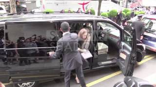 Jennifer Lawrence getting out of the George V hotel