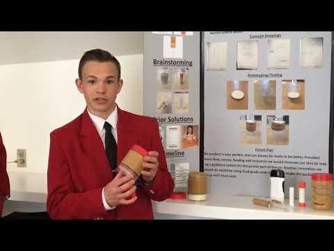 Medina career center students explain a device they designed - a better peanut butter jar