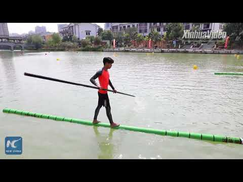 Amazing stunt: Crossing a river on a single bamboo pole