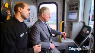 Prince Charles drives a tube train
