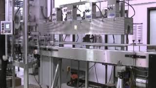 Quadrel | Labeling Systems | Heat Tunnel | Tamper Shrink Sleeve for Distilled Spirits