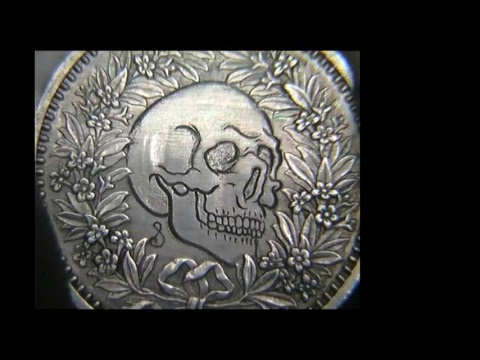 Hand engraving Tiny Skull On a Swiss Coin