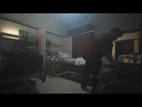 Male nurse Chris uses elderely patients water to clean floor instead of disinfectant