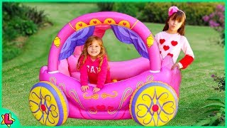 Laurinha and Helena Pretend Play with Princess Carriage Inflatable Toy