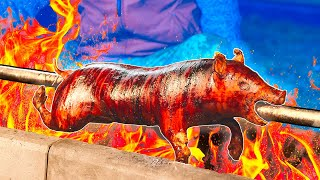 Cooked suckling pig on a spit (Lechon)