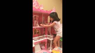Aneree playing with Elsya and Anya at barbie doll house